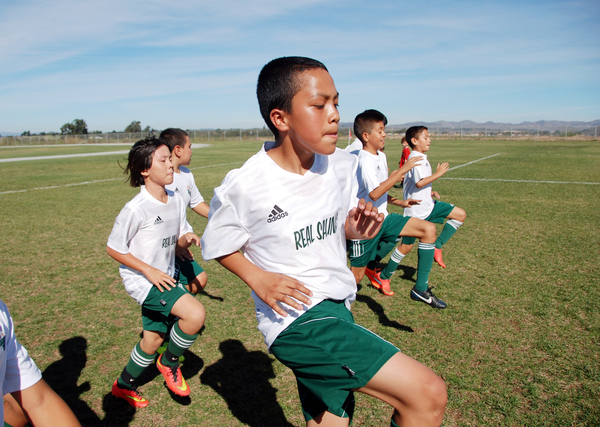For members of Real Salinas United, the boy's U-12 team, conditioning is everything for this warmup session at Bolsa Knolls Middle School in Salinas before one of their final tournament games for 2014.