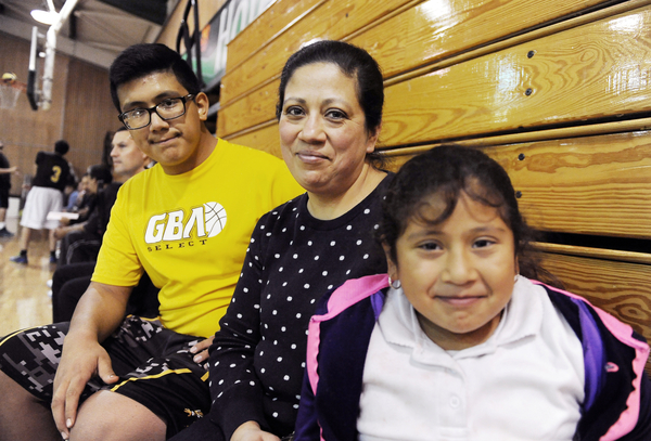Isaac Dueñas, a 7th-grader at El Sausal Middle School, gets plenty of support from his mother, Leticia, and little sister Emily, 8.